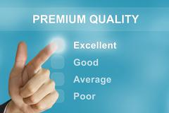 Business hand pushing premium quality button Stock Photos