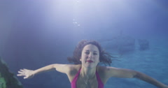 Beautiful mysterious woman in a bikini with flowing brunette hair Stock Footage