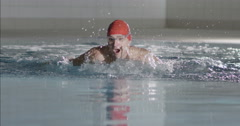 Professional male swimmer in training is doing the butterfly stroke Stock Footage