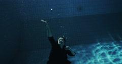 Drowning underwater businesswoman struggling Stock Footage