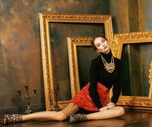 Beauty rich brunette woman in luxury interior near empty frames Kuvituskuvat