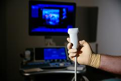 Ultrasonic investigation medical device for diagnostics in doctor hand. Hospital Stock Photos