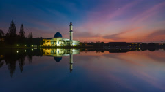 Mosque with reflection during sunrise. Time lapse Stock Footage