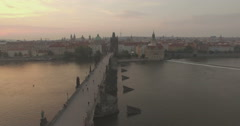 Aerial camera flies slowly towards the Charles Bridge Stock Footage