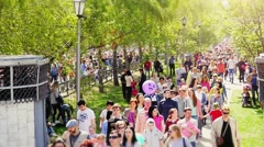 Russia, Novosibirsk, 9 may 2015. Crowd of people walking on the street in Stock Footage