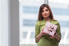 Young woman excited with giftbox Kuvituskuvat