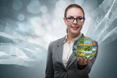 Businesswoman holding the ball with nature photos Stock Photos