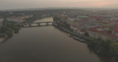 Aerial camera flies backwards fast from the Charles Bridge Stock Footage