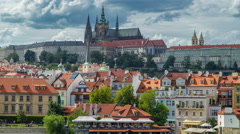 Charles Bridge and Prague Castle timelapse, view from embankment, Czech Republic Stock Footage