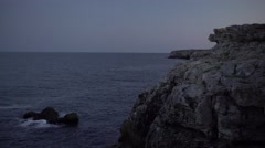 Waves and Majestic Rocks at Dawn 4K Stock Footage