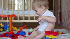The child plays with the toys in the playroom Stock Footage