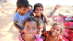 Group of Indian kids different age jumps and plays in front of camera, Stock Footage