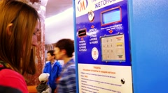 Russia, Novosibirsk, 9 may 2015. Woman buys a train ticket from vending machines Stock Footage