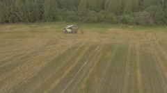 Hay stacker delivers the bales on the field Stock Footage