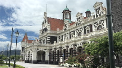 Dunedin Railway Station, mountains, New Zealand Stock Footage