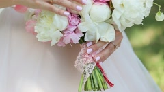 Bridal Bouquet Of Flowers In Hands Of The Bride Stock Footage