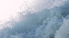 A strong flow of fresh, sea water. Flowing water, flood. Slow motion, close up Stock Footage