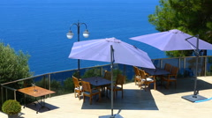 Umbrella and chair, sea background. Stock Footage