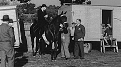 Sacramento County fair 1938: woman riding a horse Stock Footage