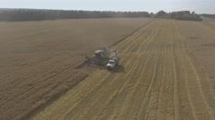 Combine grain pours into the truck Stock Footage