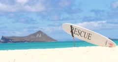 Rescue Surfboard on the Hawaii beach Stock Footage