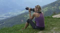 Girl photographer photographing the Austrian Alps Stock Footage