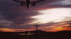 Amazing sky. A big plane is landing at the dusk, close up view. Airport lights Stock Footage