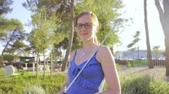 Woman portrait shot with mini golf stick 4K Stock Footage