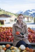 Austria, Salzburger Land, Maria Alm, Portrait of mature woman holding vegetables Stock Photos