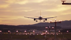 Evening sunset, big plane is landing. Airport lights are shining. No people Stock Footage