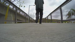 Low Angle View Man Walking Away Across Bridge - San Ysidro CA Stock Footage