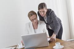 Businesswomen analyzing documents Stock Photos