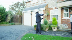 4K Mature couple with building surveyor giving them a quote for some building Stock Footage