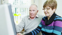 4K An elderly couple are browsing the internet together Stock Footage
