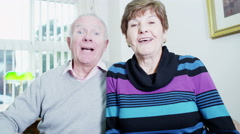 4K Elderly couple video chatting with their loved ones Stock Footage