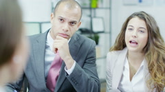 4K Three attractive business people having a meeting Stock Footage