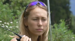 Young woman talks on a portable radio transmitter Stock Footage
