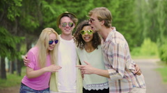 Happy friends relaxing and singing favorite song, enjoying rest outdoors, summer Stock Footage