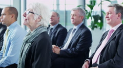 4K Diverse business group listening to presentation at a business seminar Stock Footage