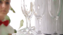 Waiter pours champagne into glasses Stock Footage