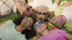 Best friends having good rest, lying on grass, joking and laughing, friendship Stock Footage
