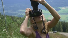 Woman has directed the DSLR camera in the sky Stock Footage