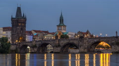 The Charles Bridge day to night timelapse over the Vltava River reflected in Stock Footage