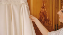 The bride embracing wedding dress and smiling Stock Footage