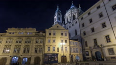 Night view of the illuminated malostranske namesti square timelapse hyperlapse Stock Footage