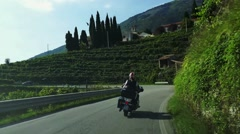 Prosecco country - Motorcyclists along the Prosecco road Stock Footage