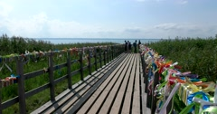 With colored ribbons, tied in with tourists, the bridge of lake Pleshcheyevo Stock Footage