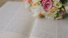 A wedding bouquet lying on the book background Stock Footage
