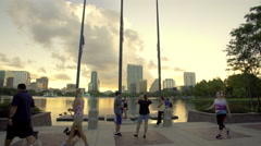 People walking by Lake Eola, Orlando downtown Stock Footage