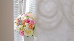 A wedding bouquet on the windowsill in white vase Stock Footage